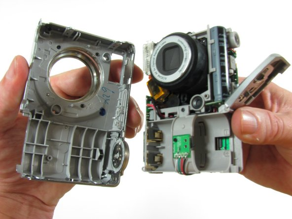 With battery door open, grasp the front case and remove it from the camera.