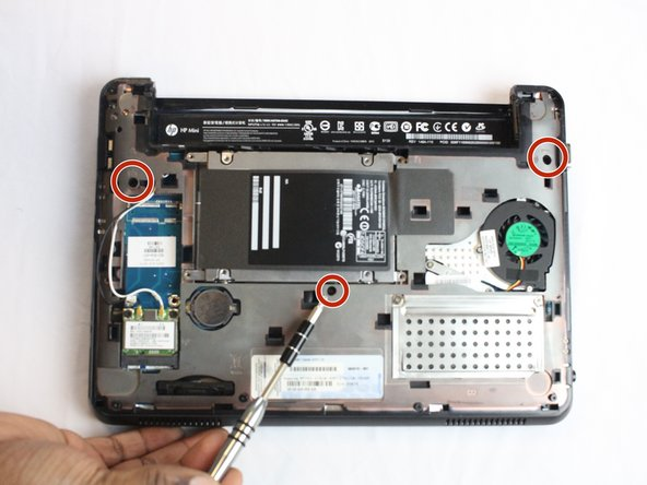 Remove the three black screws marked by the keyboard symbol using the PH1 screwdriver