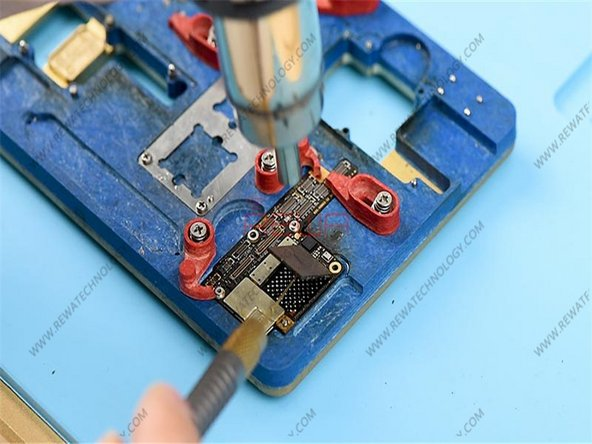 Attach the upper layer to the PCB Holder. Heat and pry up the NAND flash chip with a specialized knife.