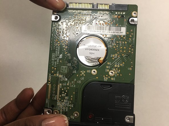 The hard drive should slide out of the laptop. However, if not, use a spudger to pry the hard drive out of the laptop.