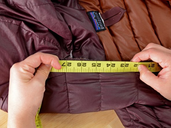 Image 3/3: The jacket should be flat, so you get an accurate measurement.