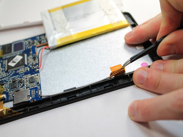 Gently peel the WIFI Antenna up using a pair of tweezers.