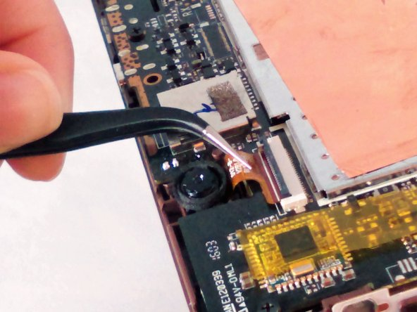 Be careful when removing the camera.  The underside of the camera head has adhesive and may be adhered to the tablet.  If this happens, use the black plastic spudger to carefully pry up on the underside of the camera head to loosen it from the tablet before pulling on the ribbon cable with the tweezers.
