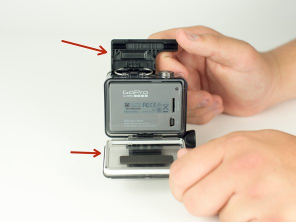 Image 1/1: Unclip the black latch to the camera case and open the case.