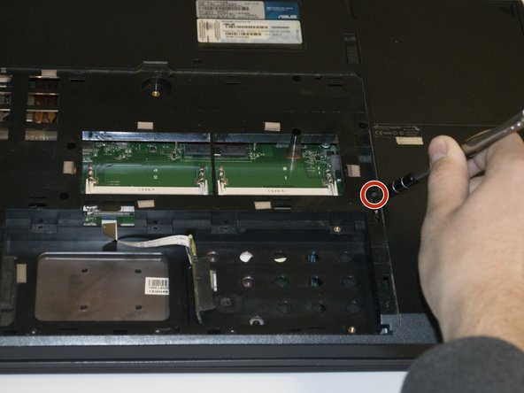 Now, unscrew and remove the 6mm Phillips #0 screw next to the optical drive.