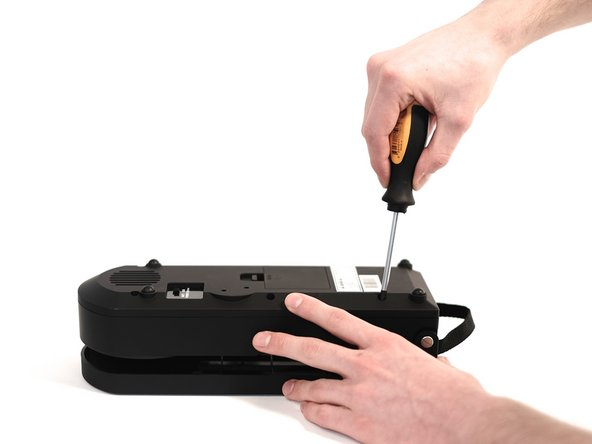 Image 2/3: Use your phillips head screwdriver to remove each screw (keep them in a safe place for later).