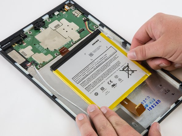 Make sure all the adhesive is removed before trying to lift the battery from the case.