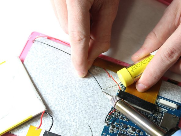 Apply heat onto the solder over the corresponding cut wires to the new screen wires.
