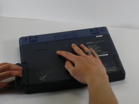 Image 2/2: To replace the floppy drive, simply slide the drive into the slot until it clicks.