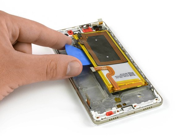 Use the pull tab as seen here in the battery guide to remove one of the adhesives strips underneath the battery.