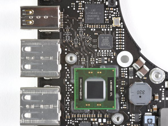 The Thunderbolt port is shown in the top left corner of the first picture. Also seen are the traces leading to what we think is the Thunderbolt controller IC.