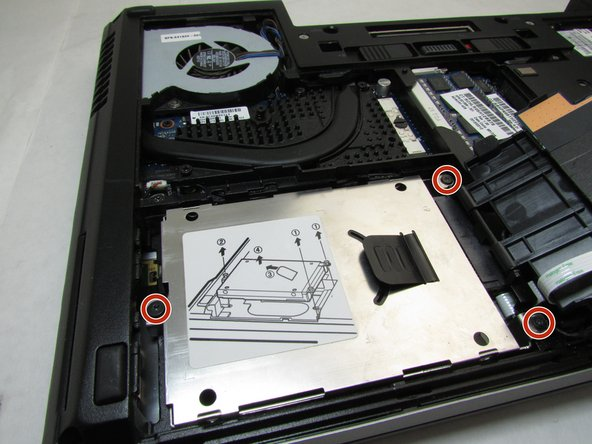 Using a Phillips #0 bit, unscrew the three screws that hold the hard drive assembly in place.