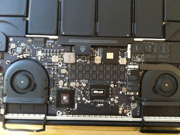Image 1/1: Re-assemble the MBP, making sure to spread out the paste evenly as you place and screw the heatsink back in. Also remember that the paste will spread as the unit heats up. DO NOT leave air pockets in the paste when covering the processor and GPU.
