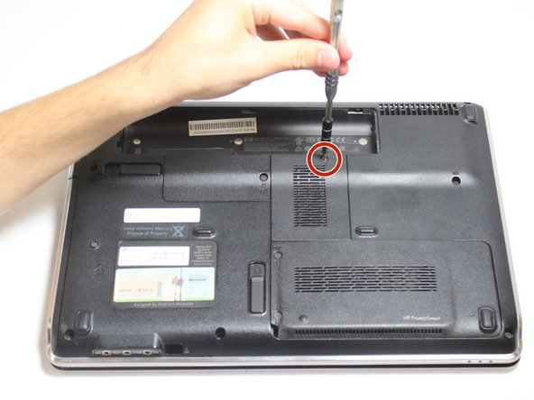 Use the Phillips #0 screw driver to unscrew the 7.5 mm screw indicated in the photo.