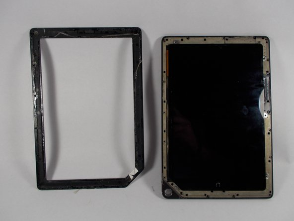 Pry the front frame off of the nook by wedging the plastic opening piece between the frame and the nook.