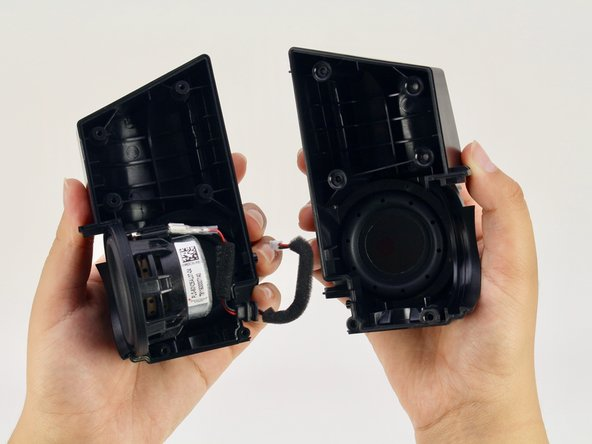 Pull apart the black casing to reveal the sound driver.