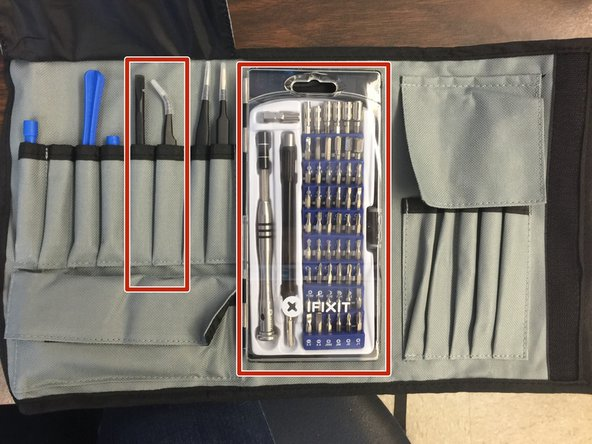 Out of the iFixit tool kit remove the black plastic opening tool, curved tweezers, and 54 bit driver kit.