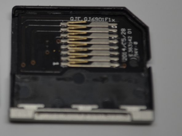 The red substance used on Nifty's circuit board (red circle) is an epoxy used instead of a clean solder.  The connection points (in the red rectangle) look poorly soldered and dismal looking compared to the TarDisk's and appears unstable against the TarDisk's cleaner chip construction.