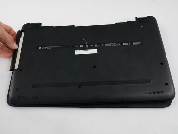 Remove the optical disk drive from the side of the laptop.