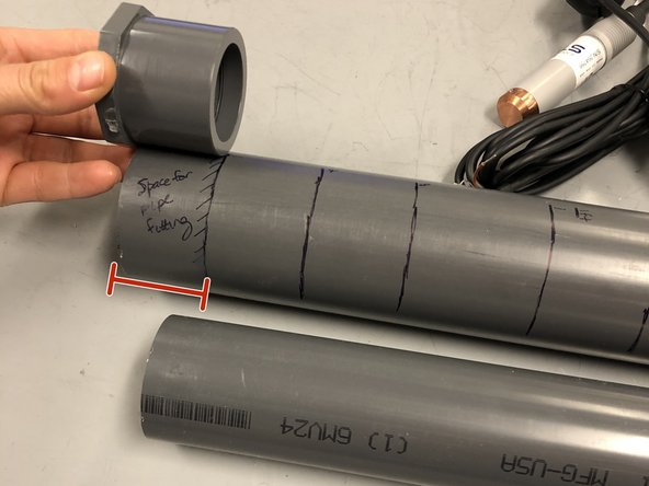 On the 2-inch pipe, make a line  1.75 inch from the bottom (to make space for the pipe bushing).  Then make a line 2.5 ft from the bottom of the foot valve for the soil moisture sensor hole.