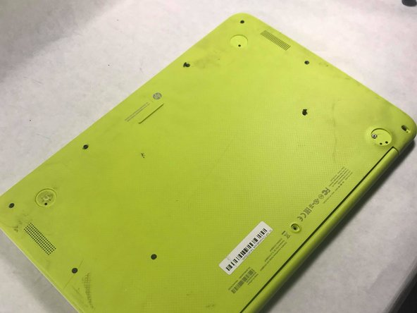 Turn the Chromebook upside down so that the bottom is facing upwards. Make sure to remove the small rubber circles and all four corners, and additional three other small rubber covers and proceed to unscrew the screws.