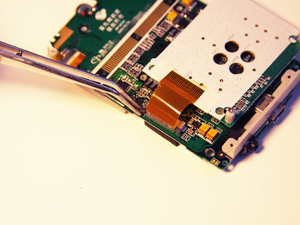 Image 2/3: The ribbon pin should snap completely off of the motherboard.