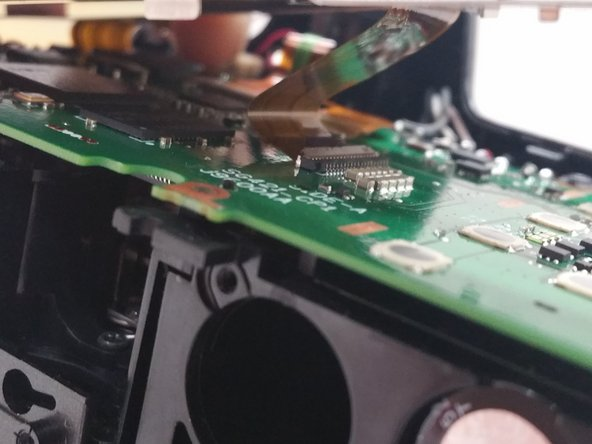 Image 3/3: Carefully remove the screen brace from the circuit board