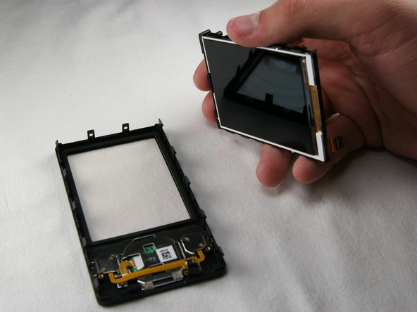 Gently pry the screen unit from the black, plastic front frame.