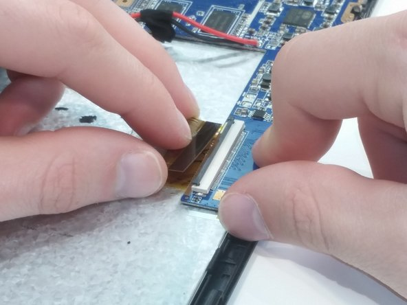 Image 3/3: Remove both ZIF connectors by lifting the flap on the connectors and carefully removing the ribbons.