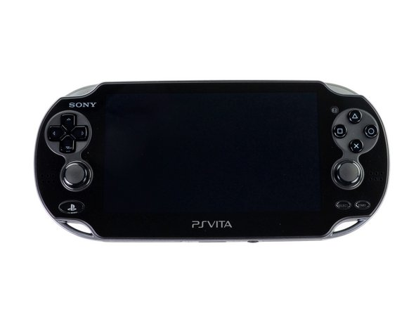 Image 1/3: The bottom side of the PS Vita is left relatively bare and is occupied by the charging port, headphone jack, and the memory card door.