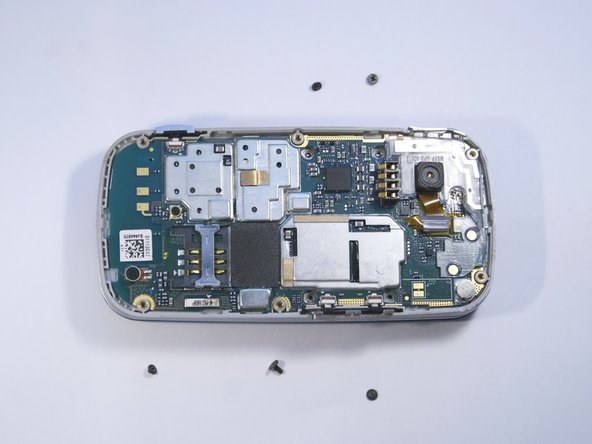 Use a PH000 screwdriver to remove the five 2 mm screws holding the camera in place.