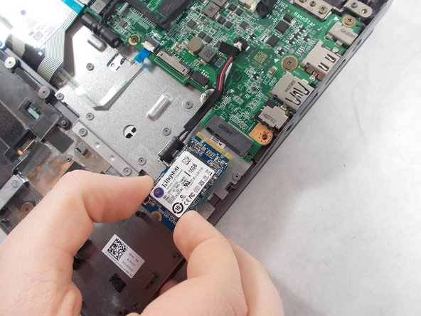 Carefully pull out the solid state drive using two fingers.