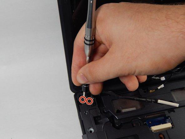 Unscrew them using the PH0 screwdriver.