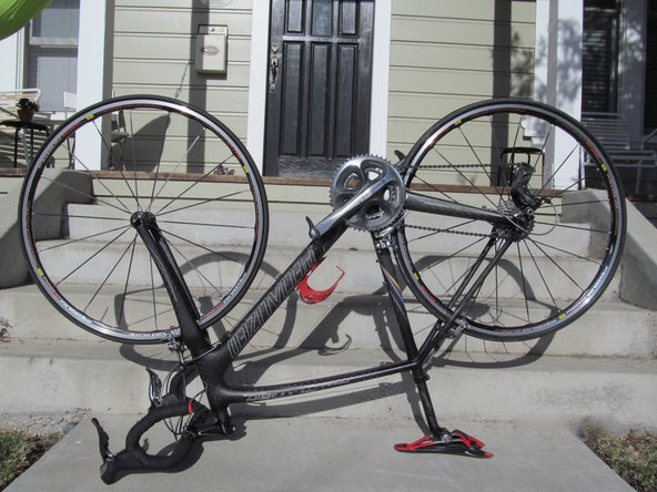 To easily remove the rear wheel, flip the bike upside down so that it's sitting on the handle bars and seat.