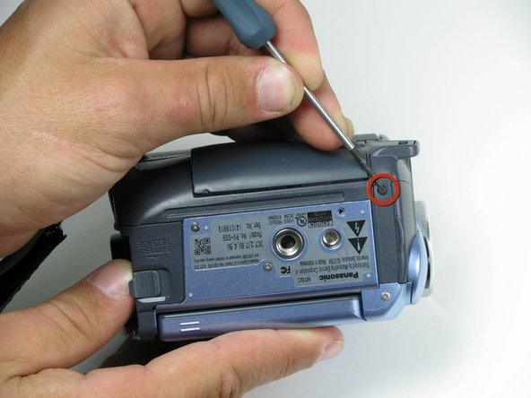 Image 1/2: Next, while still having the bottom of the camcorder facing you, remove the four silver 4.5mm screws from the body.