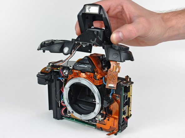 Remove the top cover from the D70, minding any cables that may get caught.