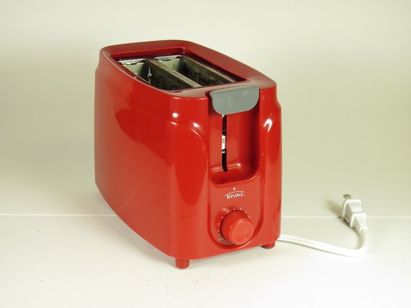 "Image 1/2: Turn the toaster upside down and remove the rubber stopper ""feet"" with your fingers."