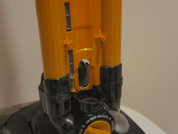 Upon removal of the two screws, the accessory holder can be removed from the vacuum body.