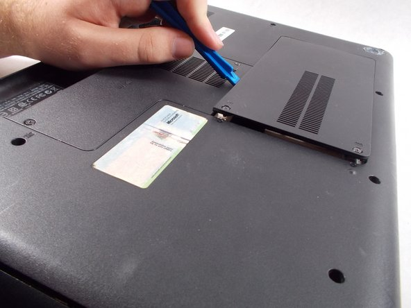Gently remove the panel with a plastic opening tool.
