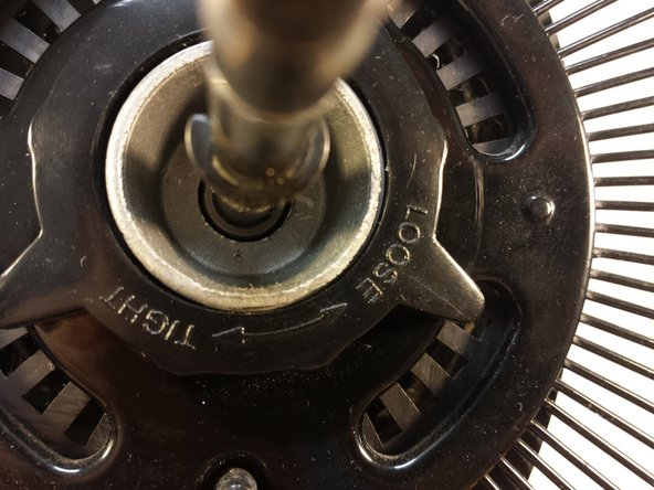 Image 2/3: Like the first knob, be sure to check for the labelings to see which direction you should be turning. On this fan, I have to twist counter-clockwise this time (this time, lefty-loosy!).