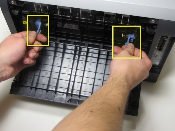 Once you have a firm grib of both the right and left tab, lift both tabs up and towards yourself.