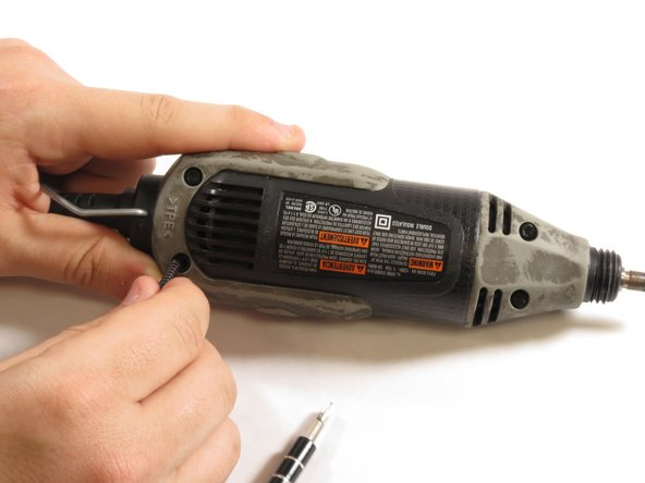 Remove the 4 screws located on the bottom of the Multipro with a T15 screwdriver.