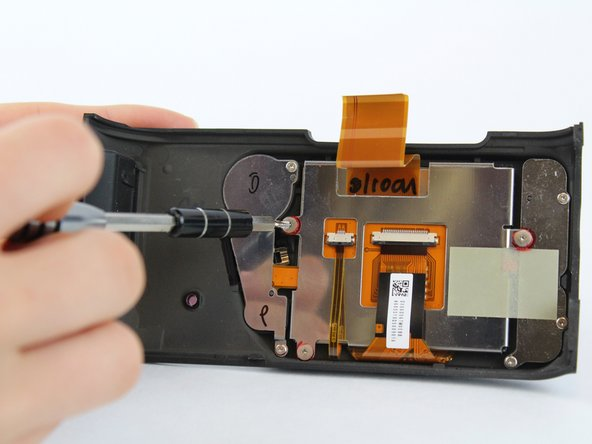 Use the Phillips #00 screwdriver to remove the two 3.4 mm screws.