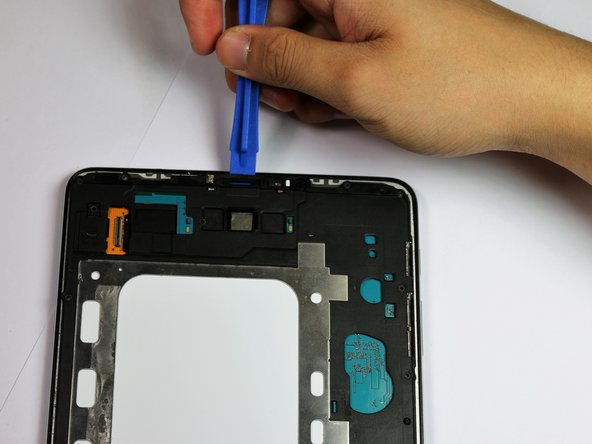 Use the plastic opening tool to lift and remove the plastic motherboard cover.