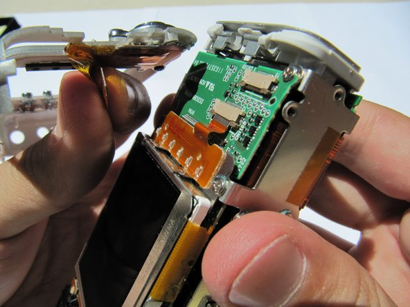 Gently pull the  orange tab out of the  circuit board.