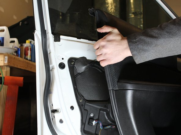 Lift the door panel up and out to remove.