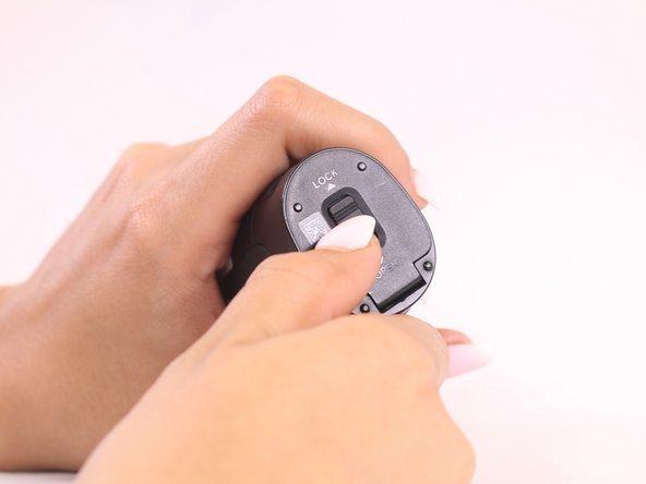 Open the battery compartment by locating the bottom of the handle, and pushing the slider forward.