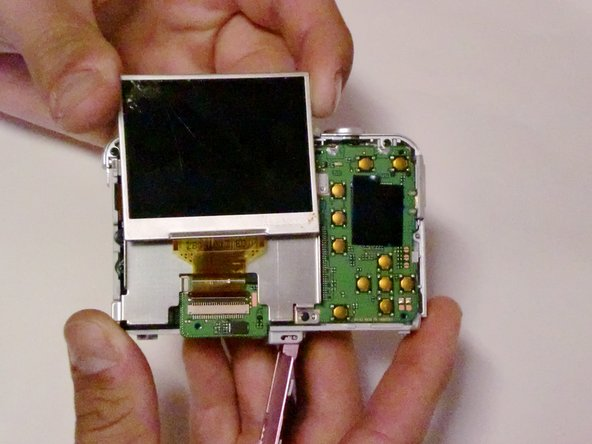 Image 1/2: Remove the LCD screen from the screen plate.