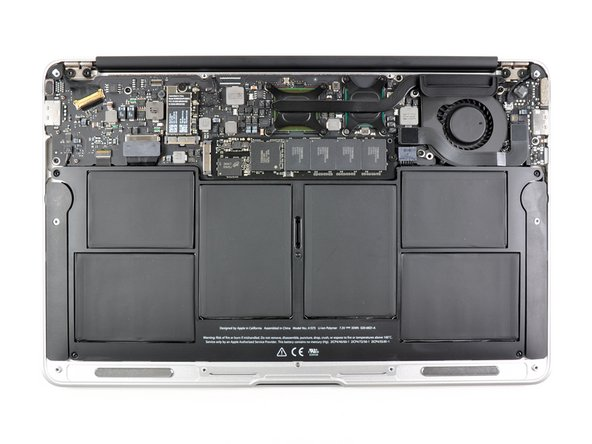 Image 2/2: The inside of the MacBook Air is dominated by six individual lithium-polymer cells making up the 35 Wh battery.