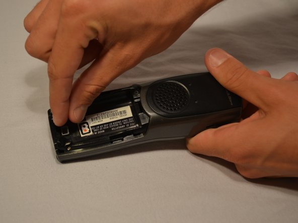 Once battery cover is removed, place your thumb and index fingers on the the wires near the receptacle